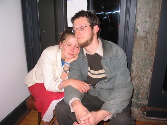Lily Mulberry leans on friend Kirk Mayhew after opening night for her gallery, 1305 Gallery, in April 2005.