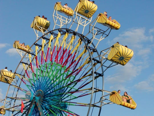 In the late afternoon, Ferris wheel riders enjoy the Boone County 4-H & Utopia Fair last year.