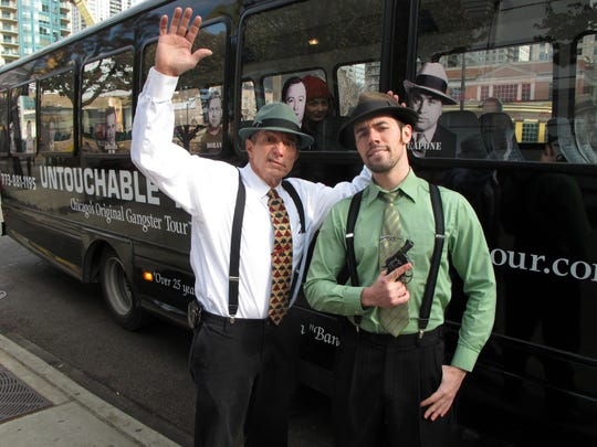 Tom Schergen, left, and Jay Donley ham it up before another Original Chicago Gangster Tour begins in Chicago.