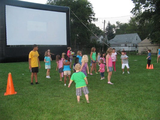 Berkley movie screen and kids.jpg