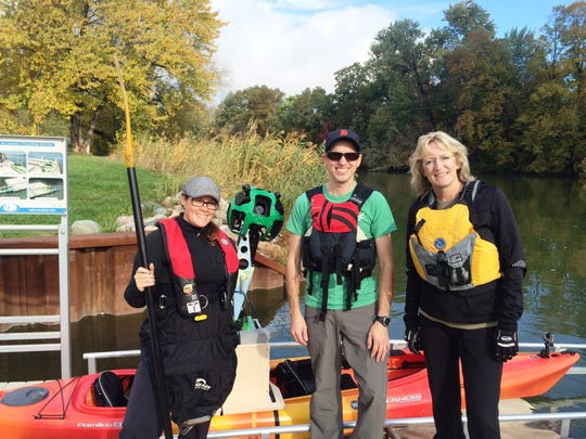 Missy Campau, left, Robert Wilson and Lori Eschenburg prepare to paddled the Island Loop National Water Trail with the Google Street View Trekker. The water trail and the Fort Gratiot Light Station County Park are two of 12 Michigan destinations showcased through Street View in Google Maps.