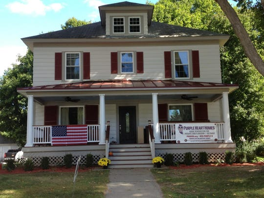 The home of Pvt. Dan Flanigan in Pawling after renovations. A ribbon cutting was held at the house Saturday to mark completion of the project, made possible by scores of volunteers and donations.