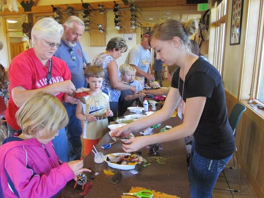 Families take part in craft activities during a Grandparents Day event Sunday at Mead Wildlife Area in Milladore.