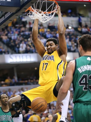 Pacers center Andrew Bynum throws down a dunk for his very first points as a Pacer in the first half of Tuesday's game against Boston at Bankers Life Fieldhouse on Tuesday, March 11, 2014. Bynum made his debut with the Indiana Pacers tonight against the Boston Celtics, playing in his first NBA game in nearly three months.