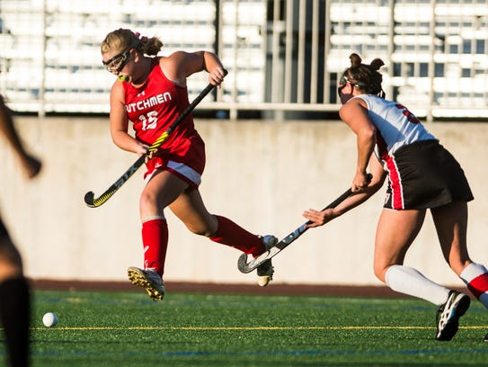 Annville-Cleona's Emily Brightbill leaps over the stick