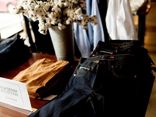 """Raw denim jeans named the """"Andy"""" on display at the Marc Nelson store on 700 E Depot Ave in Knoxville, Tennessee on Friday, May 25, 2018. Nelson has recently returned to working at his denim business after serving time in prison for money laundering."""