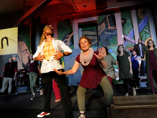 """Mark Rogers, playing Samson, shows his """"abs"""" as Kim Hardin sings next to him during dress rehearsal in 2017 for """"Samuel the Unexpected Prophet"""" at Southern Hills Church of Christ. The homegrown musical during the summer is a church tradition."""