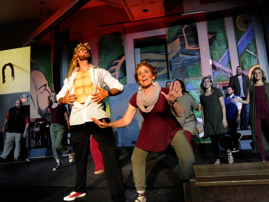 """Mark Rogers, playing Samson, shows his """"abs"""" as Kim Hardin sings next to him during dress rehearsal for """"Samuel the Unexpected Prophet"""" at Southern Hills Church of Christ. The homegrown musical staged in July 2017 was based on the Old Testament prophet."""