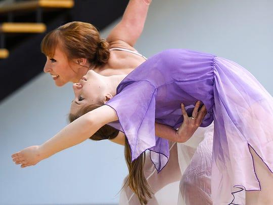 Catie Bunde, back, and Kerri Golombecki of the Minnesota