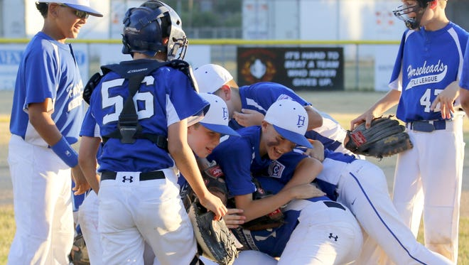 Horseheads players celebrate after defeating Waverly to win Friday's District 6 Little League 10-11 championship at Kevin Cicci Little League Field in Elmira Heights.