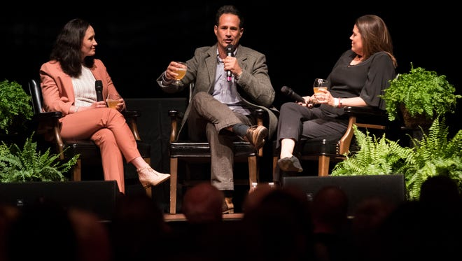 Karissa Thacker, left, speaks with Dogfish Head Craft Brewery Inc. founders Sam Calagione, center, and Mariah Calagione during the 2018 Delaware History Makers Award & Celebration Thursday night in Wilmington.