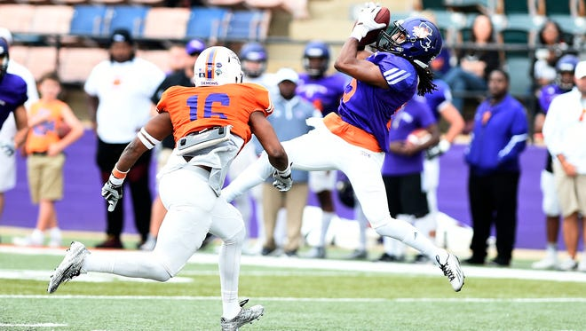 Northwestern State's Shakeir Ryan catches a pass during the Delaney Bowl on Saturday.