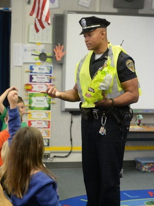 Officer Tim Davis discusses trick-or-treat safety with first-graders at Westview Elementary School.