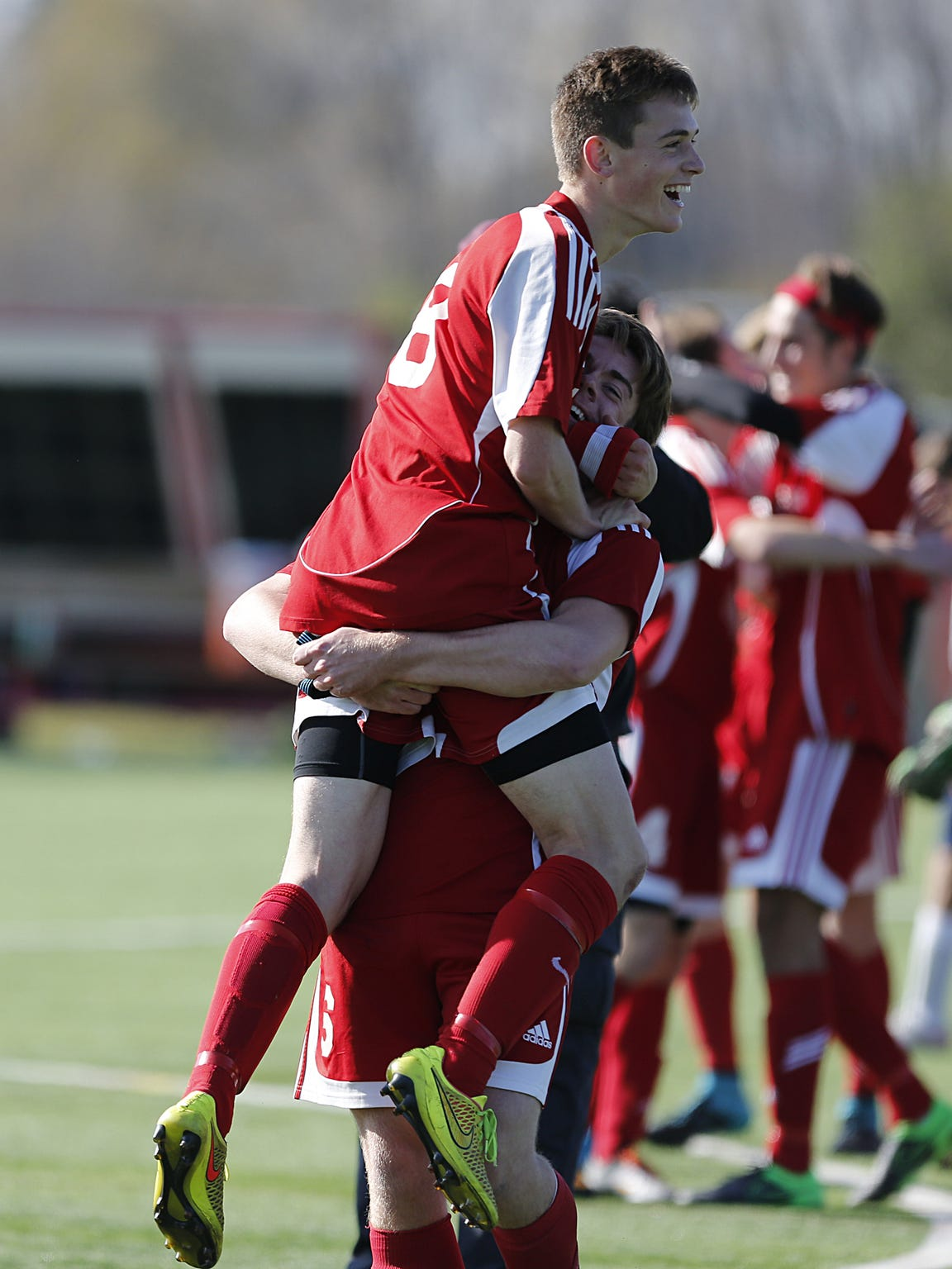 Sturgeon Bay's Levi Haight celebrates with a teammate during the Clippers' 2-0 win in the WIAA Division 4 state title game on Nov. 7.