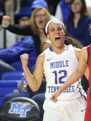 MTSU's Brea Edwards (12) celebrates after hitting her fifth 3-pointer in the first half of the game. against Western Kentucky, on Saturday, Jan. 30, 2016, at MTSU.