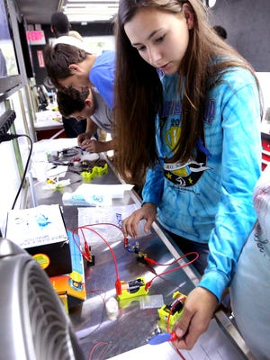 Oakland Senior Yelana Barrett works to build a circuit on the Tennessee Tech Stem bus that vistited the school, on Monday, Sept. 13, 2016.
