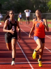 Blackman's Tanalya Gordon, right, competes during the county meet earlier this season.