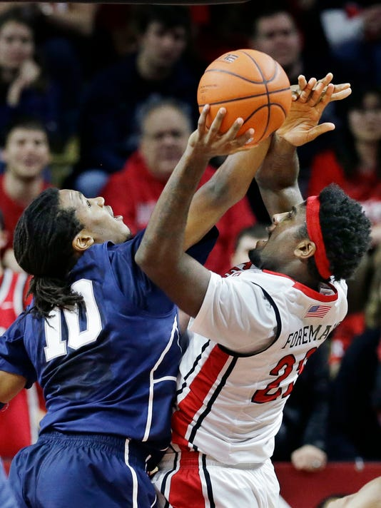 Rutgers' D.J Foreman (22) shoots as Penn State's Brandon Taylor (10) tries to block his path during the first half of an NCAA college basketball game Saturday, Jan. 3, 2015, in Piscataway, N.J. (AP Photo/Mel Evans)