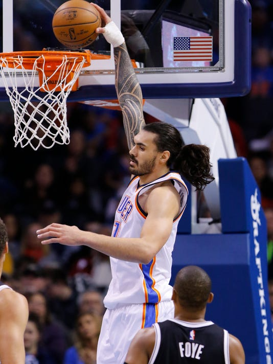 Oklahoma City Thunder center Steven Adams (12) goes to the basket in front of Brooklyn Nets guard Randy Foye (2) during the first half of an NBA basketball game in Oklahoma City, Friday, Nov. 18, 2016. (AP Photo/Alonzo Adams)