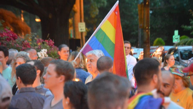Supporters of the LGBT community gather in Wilmington on June 13 following the shooting at the Pulse nightclub in Orlando, Fla., where 49 were killed. A new study says Delaware cities fall below the national average in advocating for LGBT rights.