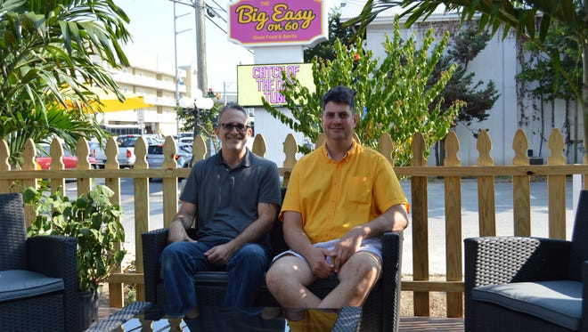 Owner of The Big Easy on 60, Mark Hall (right) sits with restaurant manager, Lewis Sherman.