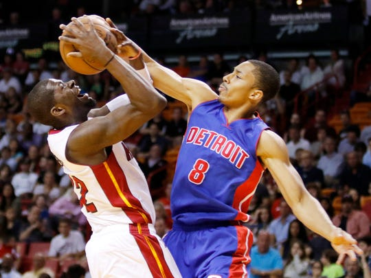 Miami Heat forward James Ennis, left, is fouled by