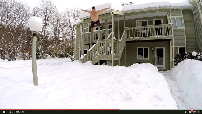 Thrill-seeking residents in Boston are taking to social media with videos of them jumping out of windows into massive snow drifts.