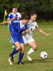 Spackenkill's Caitlin Speranza, right, fights for the