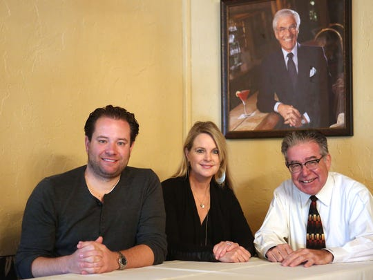 From left; Jeremy Scherer co-president and partner of the PlumpJack Group, Hilary Newsom, president and partner of the PlumpJack Group and Brian Ellis longtime Melvyn's employee sit at Mel Haber's favorite table under a portrait of him, December 13, 2016.