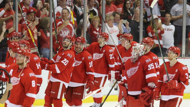 The Detroit Red Wings salute the fans after the 4-1 win over the New Jersey Devils on April 9, 2017, at Joe Louis Arena in the final game at the Joe.