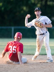 Red Lion's Bren Taylor, turns a double play during