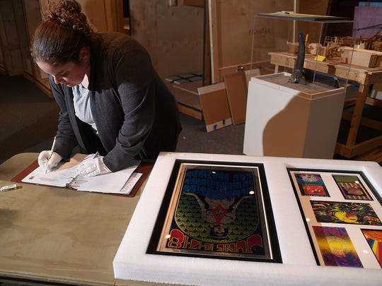 "Collections Manager Lizz Ricci processes pieces from the ""Technicolor Dreaming: Psychedelic Posters from the Rock and Roll Hall of Fame"" show opening this weekend at the Farmington Museum at Gateway Park."