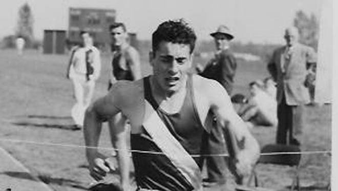 Dick McKimson competes in a relay for Olympic College in the early 1950s. McKimson, who also played football for OC, will be inducted into the school's hall of fame next month.