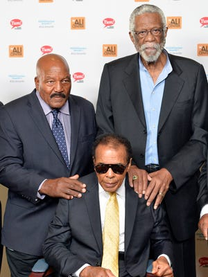 Muhammad Ali, center, with Jim Brown, left, and Bill Russell at the Ali Humanitarian Awards ceremony on Sept. 27.