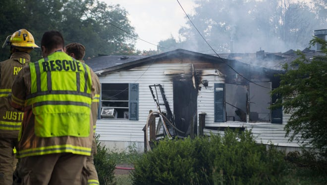 Rural Metro responds to a house fire on Candora Ave. in Knox County, Thursday, June 14, 2018.