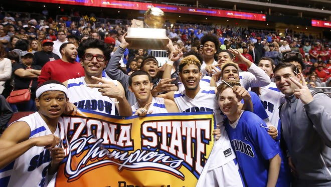 Shadow Mountain celebrates winning the high school boys basketball: 4A Conference state championship game against the Salpointe off court at Gila River Arena in Glendale on February 25, 2017. Shadow Mountain Jaelen House (2) was not allowed on the court after being ejected from the game.