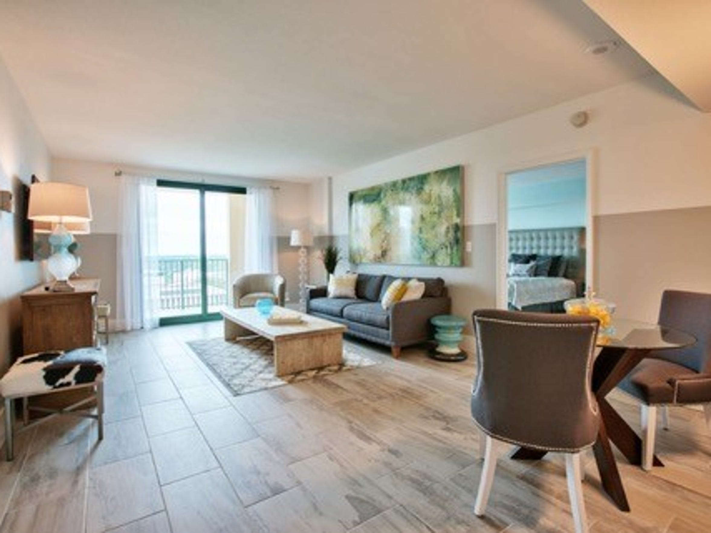 Here's a model unit at the Plaza Tower with staged furniture. For years, the high-rise didn't sell any units but an ambitious marketing plan hopes to turn things around.