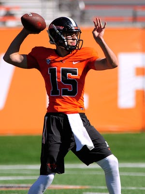 Oregon State quarterback Tanner Sanders throws the ball during spring practice inside Reser Stadium, on Saturday, March 7, 2015, in Corvallis.