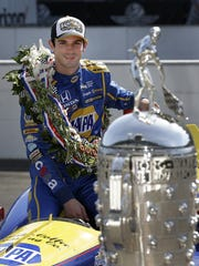 IndyCar driver Alexander Rossi (98) poses for photos following his win in the 100th running of the Indianapolis 500 Monday, May 30, 2016, at the Indianapolis Motor Speedway.