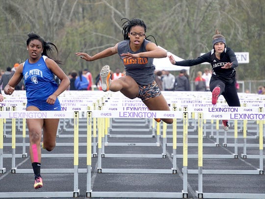 Mansfield Senior's Alaya Grose beats former teammate Alysse Wade of St. Peter's to the finish line in the 100 meter hurdles at last week's Lexington Invitational.