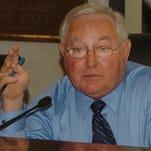 St. Landry Parish President Bill Fontenot is questioned by council members in this Daily World file photo.
