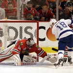 Tampa Bay Lightning's Ondrej Palat scores past Chicago Blackhawks goalie Corey Crawford during the third period in Game 3 of the NHL hockey Stanley Cup Final on Monday in Chicago. The Kightning won 3-2