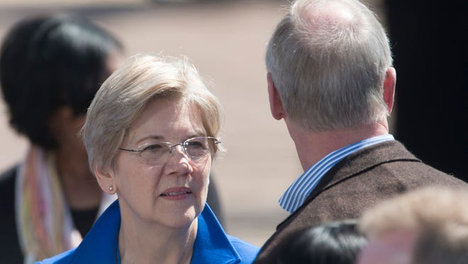 U.S. Senator Elizabeth Warren, (D-Mass.), speaks to others  before President Barack Obama's scheduled speech on the 50th anniversary of Bloody Sunday at the foot of the Edmund Pettus Bridge in Selma, Ala., on Saturday, March 7, 2015.