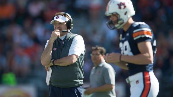 Auburn head coach Gus Malzahn looks on during Auburn's