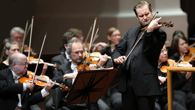 The Indianapolis Symphony Orchestra performed a piece composed by principal trombone player Jim Beckel that featured a childhood melody written by violinist Zach De Pue.