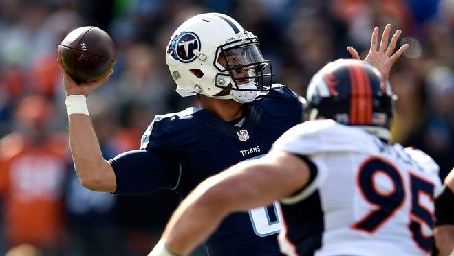 Titans quarterback Marcus Mariota (8) passes at Nissan Stadium Sunday, Dec. 11, 2016, in Nashville, Tenn.