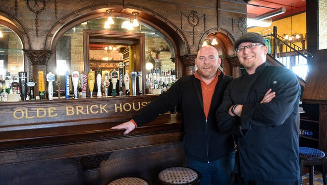 Managing partner Brandon Gunderson and head chef Justin Berhow stand in front of the bar Friday, Feb. 17, at the Olde Brick House in St. Cloud.