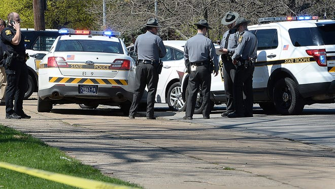 Pennsylvania State Police investigate the scene where Steve Stephens, the suspect in the random killing of a Cleveland retiree posted on Facebook,  was found shot dead Tuesday, April 18, 2017, in Erie. Pa.