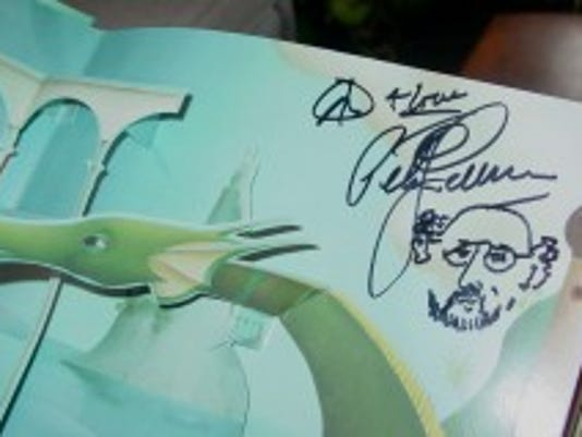 """The children's book """"Puff the Magic Dragon,"""" to be auctioned off March 24, is signed by Peter Yarrow of Peter, Paul and Mary fame. (Submitted)"""