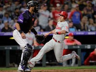 Phillies get HRs from Harper, McCutchen to beat Rockies 8-5
